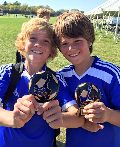 My son and his team mate and trophy
