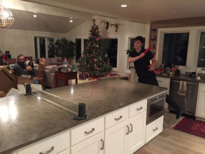 Family Playing Ping Pong in Kitchen
